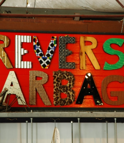 Reverse Garbage sign made out of recycled materials